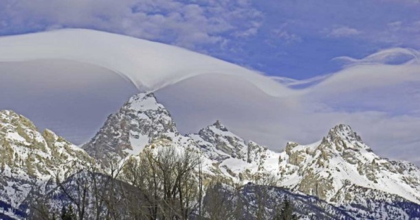 CLOUD DANCE OVER GRAND TETONS AT YELLOWSTONE TAKEN THURSDAY, FEBRUARY 12, 2015 BY A PARK SPOKESPERSON. SENT BY WISE OWL DINAH.